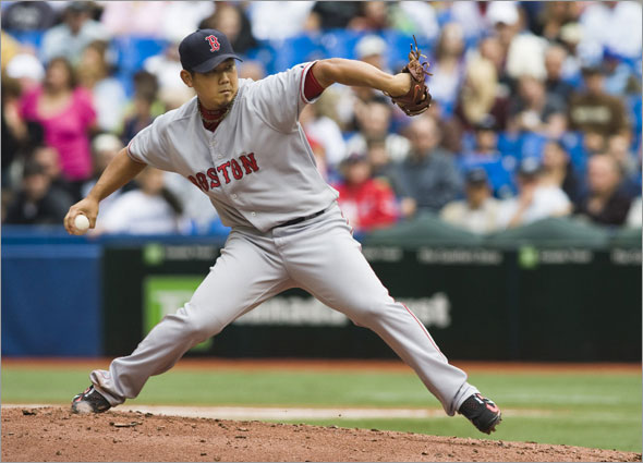 Red Sox pitcher Daisuke Matsuzaka throws to the Toronto Blue Jays during the fourth inning of their American League MLB baseball game in Toronto, September 21, 2008.