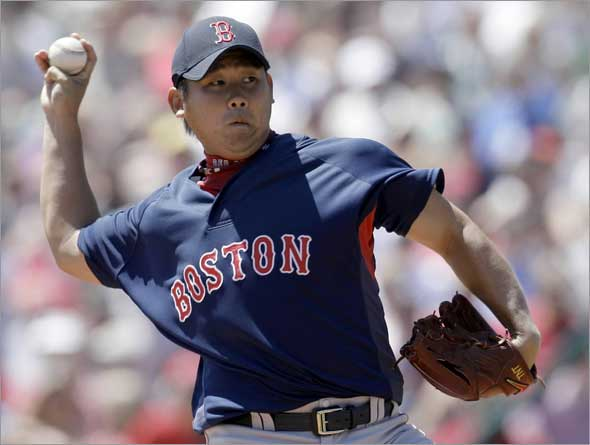 Boston Red Sox pitcher Daisuke Matsuzaka, of Japan, throws to an Atlanta Braves batter during the second inning of a spring training baseball game, Monday, March 30, 2009, in Kissimmee, Fla.