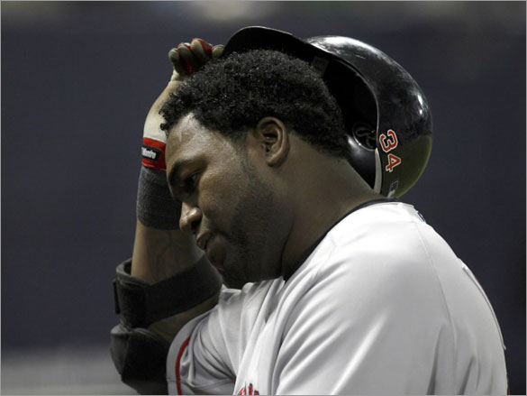 Red Sox David Ortiz takes off his helmet as he walks back to the dugout after popping up to Minnesota Twins Mike Lamb with men on base during the fifth inning of their American League baseball game at the Metrodome in Minneapolis, May 12, 2008