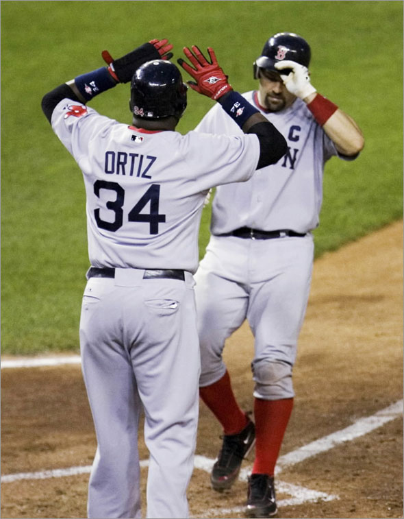 Boston Red Sox's Jason Varitek, right, is greeted at the home plate by David Ortiz (34) after Ortiz scored on Varitek's home run during the sixth inning of a baseball game Wednesday, June 24, 2009, in Washington. The Red Sox won 6-4.