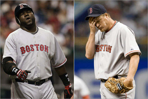 Boston Red Sox's David Ortiz reacts after flying out with two runners on base during the ninth-inning against the Tampa Bay Rays in a baseball game Friday night April 25, 2008, in St. Petersburg, Fla. Red Sox pitcher Mike Timlin wipes his brow during the 11th inning. The Rays won the game 5-4 in 11-innings.