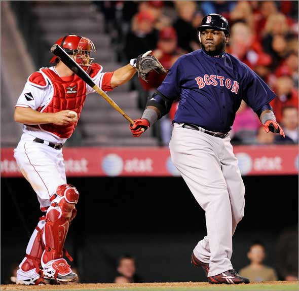 David Ortiz of the Boston Red Sox strikes out as catcher Jeff Mathis the Los Angeles Angels reacts during the eight inning at Angel Stadium April 10, 2009 in Anaheim, California. Angels won, 6-3.