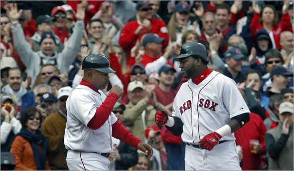 Red Sox DH David Ortiz rips a two run triple to center field in the sixth inning that Baltimore's Felix Pie leapt for but couldn't come down with, and Ortiz gets a hand from third base coach DeMarlo Hale and the crowd as he pulls into third base.