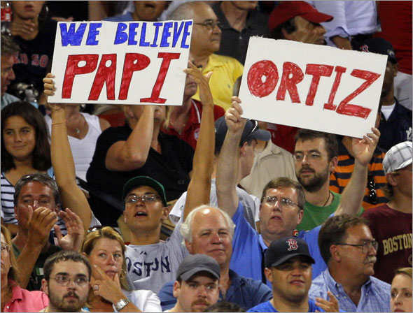 Fans show their support for Boston Red Sox's David Ortiz as he comes up to bat in the fourth inning of their MLB American League baseball game against the Detroit Tigers at Fenway Park in Boston, Massachusetts August 10, 2009.