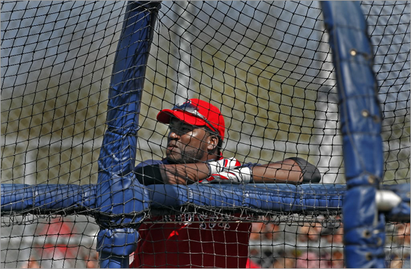 Red Sox DH David Ortiz spoke at length after the workout this morning about his left wrist injury and the steriod questions that surround the game of baseball. Here he is shown as he waits for his turn to hit in the batting cage.