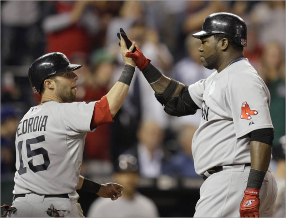 David Ortiz, right, celebrates with Dustin Pedroia (15) after Ortiz hit a three-run home run during the eighth inning of a baseball game against the Kansas City Royals on Wednesday, Sept. 23, 2009, in Kansas City, Mo.
