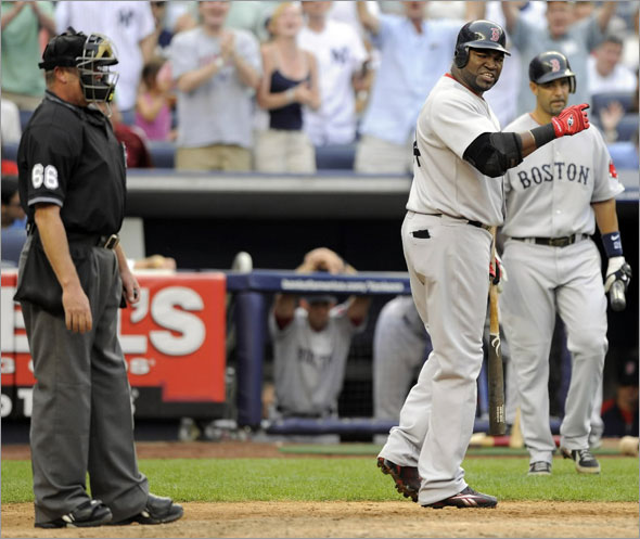 Boston Red Sox batter David Ortiz reacts after umpire Jim Joyce called him out on strikes with two runners on base against the New York Yankees in the seventh inning of their MLB American League baseball game at Yankee Stadium in New York August 8, 2009.