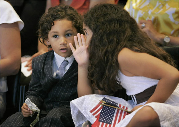 Children of David Ortiz, D'Angelo, left, and Alexandra, right, whisper to one another during naturalization ceremonies at the John F. Kennedy Library, in Boston, Wednesday, June 11, 2008. Ortiz took the oath of citizenship along with 220 other immigrants during the ceremony.