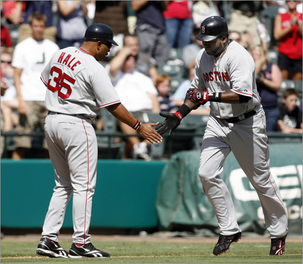 Red Sox designated hitter David Ortiz (R) is congratulated by third base coach DeMarlo Hale after hitting a two-run homerun against the Texas Rangers in the fifth inning of their MLB American League baseball game in Arlington, Texas September 7, 2008.