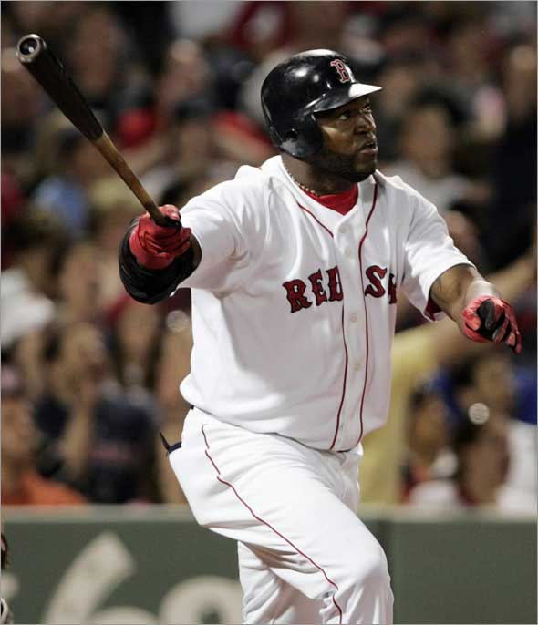 Boston Red Sox designated hitter David Ortiz watches his two-run home run against the Toronto Blue Jays during the fifth inning of their American League MLB baseball game at Fenway Park in Boston, Massachusetts May 20, 2009. It was Ortiz's first home run of the season.