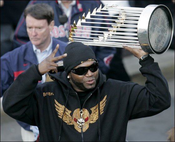 Boston Red Sox's David Ortiz holds up the World Series trophy in front of a crowd outside Boston's Fenway Park moments after returning from Denver, Monday, Oct. 29, 2007. The Red Sox beat the Colorado Rockies, 4-3, in Game 4 Sunday, Oct. 28, 2007, at Coors Field in Denver, to sweep the series 4-0.