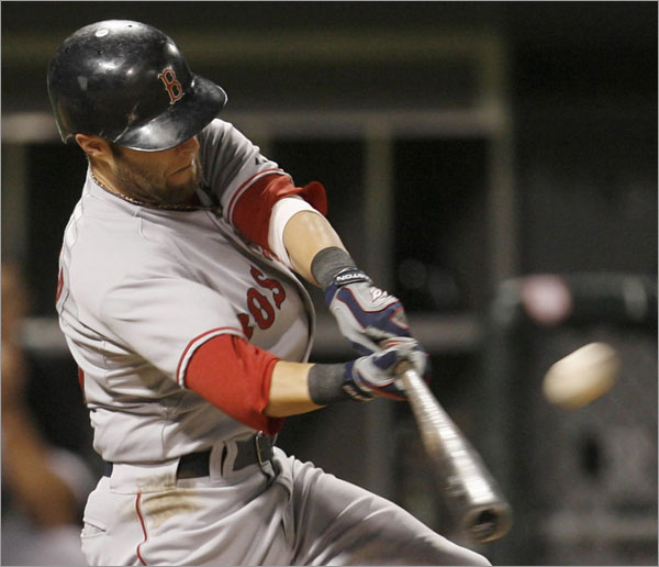 Red Sox's Dustin Pedroia hits a three-run home run against the Chicago White Sox during the eighth inning of a baseball game Friday, Aug. 8, 2008, in Chicago.