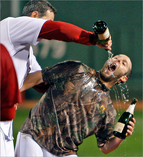 9.23.08: Dustin Pedroia (right) celebrating on the field with teammate Mike Lowell (left) after the Red Sox defeated the Indians to clinch a playoff berth.