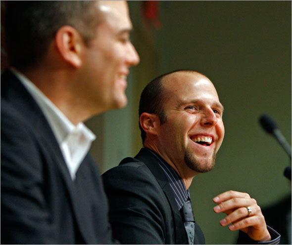 Red Sox second baseman Dustin Pedroia has over 40 million reasons to smile, as he is joined by GM Theo Epstein as they announce his new long term contract with the team.