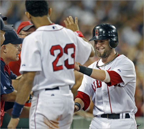 Dustin Pedroia is all smiles as he comes into the dugout after scoring the only run of the game in the bottom of the eighth inning. He led off the frame with a double, and later scored from thirdbase on a Manny Ramirez single.
