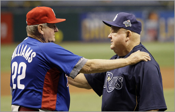 Philadelphia Phillies bench coach Jimy Williams, left, talks to Tampa Bay Rays senior baseball advisor Don Zimmer before Game 1 of the baseball World Series in St. Petersburg, Fla., Wednesday, Oct. 22, 2008.