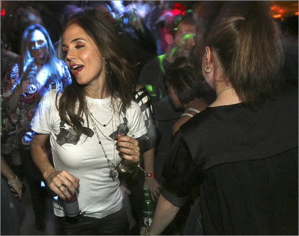 Actress Eliza Dushku (center) dances with friends at her private party held at The Estate in Boston. (ARAM BOGHOSIAN FOR THE BOSTON GLOBE)