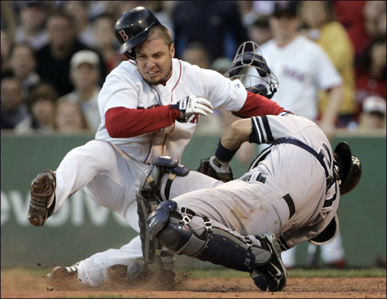 ' Eric Hinske collides with New York Yankees catcher Jorge Posada as he is tagged out trying to score on a fielder's choice hit by Dustin Pedroia in the sixth inning inning at Fenway Park in Boston, September 15, 2007.