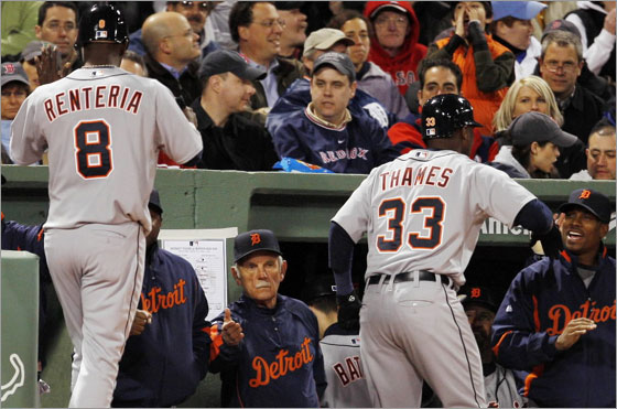 Detroit Tigers Edgar Renteria (L) and Marcus Thames are congratulated by their teammates, including manager Jim Leyland (C), after they scored on Thames' two-run home run against the Boston Red Sox in the fourth inning of their MLB baseball game in Boston, Massachusetts April 9, 2008