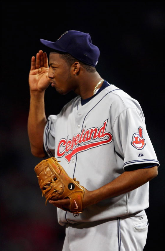 Starting pitcher Fausto Carmona No. 55 of the Cleveland Indians reacts to a play while playing against the Boston Red Sox during Game Two of the American League Championship Series at Fenway Park on October 13, 2007 in Boston, Massachusetts