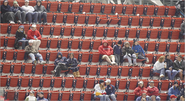 Empty seats with some fans in the stands in the ninth inning. The Tampa Bay Rays plays the Boston Red Sox in game three of the American League Championship Series (ALCS) Monday, Oct. 13, 2008 at Fenway.