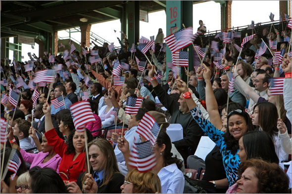 Over 3000 new citizens sworn in at the first naturalization ceremony ever held at Fenway Park in front of the Red Sox dugout.