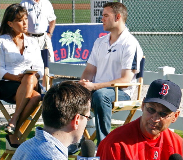 Red Sox brass were busy this morning doing interviews at the same time, as manager Terry Francona (front right) sits down with Gary Tanguay (front left) of Comcast Sportsnet, and GM Theo Epstein (back right) does the same with Hazel Mae (back left) of the MLB Network.