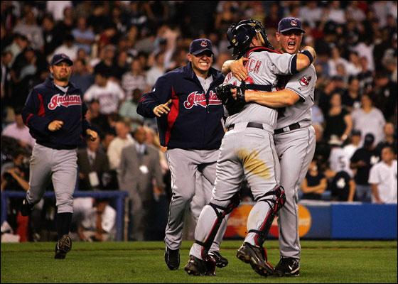 Joe Borowski  and Kelly Shoppach of the Cleveland Indians celebrate after defeating the New York Yankees by the score of 6-4 to win the American League Division Series in four games at Yankee Stadium on October 8, 2007 in the Bronx borough of New York City.