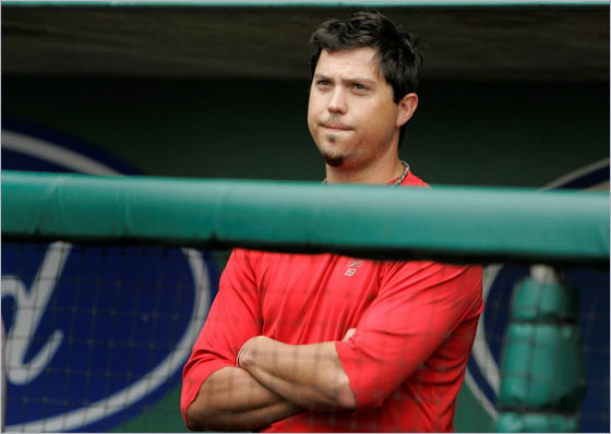 Red Sox pitcher Josh Beckett watches his teammates during a morning Spring Training baseball practice in Fort Myers, Fla., Tuesday March 11, 2008. Beckett injured his back while warming up for an outing on Saturday and is not expected to make his next start in the rotation.