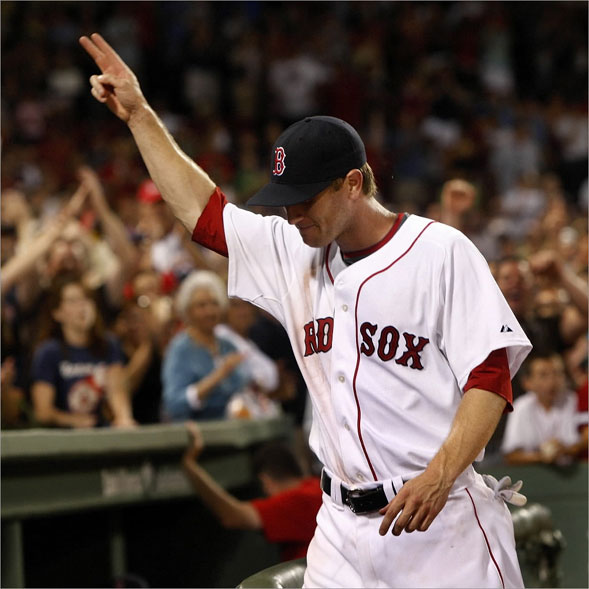 08/01/08 - Boston Red Sox left fielder Jason Bay acknowledges the fans after he scored the game winning run on a RBI single by Jed Lowrie, not pictured.