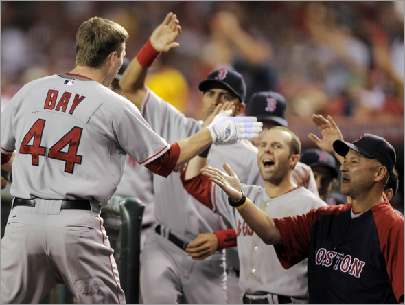 Jason Bay is congratulated by teammates after hitting a two-run home run during the sixth inning of Game 1 of baseball's American League division series against the Los Angeles Angels in Anaheim, Calif., Wednesday, Oct. 1, 2008.