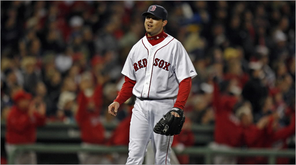 Everyone knows that Jeff Napoli's third inning home run is gone, including Josh Beckett, who doesn't even turnaround to watch it, while the Angels dugout celebrate. Jim Davis/Globe Staff) section:sports slug:sox06 Red Sox vs Los Angeles Angels in game 3 of the ALDS series at Fenway.g