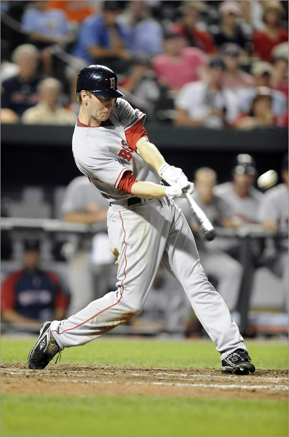 Jason Bay of the Boston Red Sox hits a home run in the eighth inning against the Baltimore Orioles August 18, 2008 at Camden Yards in Baltimore, Maryland. (