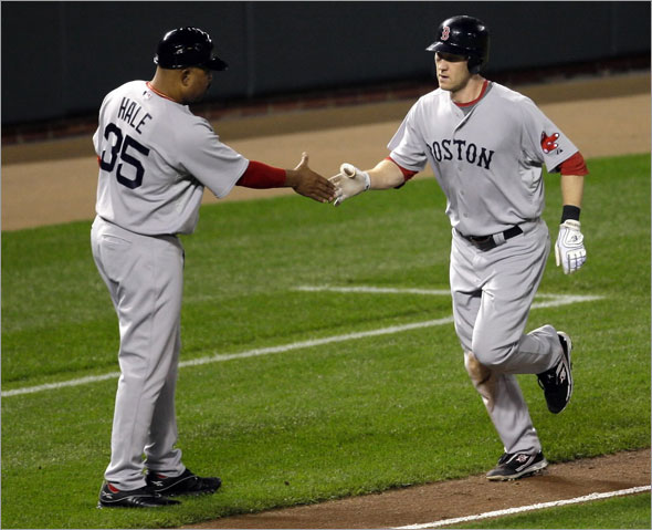 Jason Bay, right, is congratulated by third base coach DeMarlo Hale (35) after hitting a solo home run against the Baltimore Orioles during the fourth inning of a baseball game, Friday, Sept. 18, 2009,