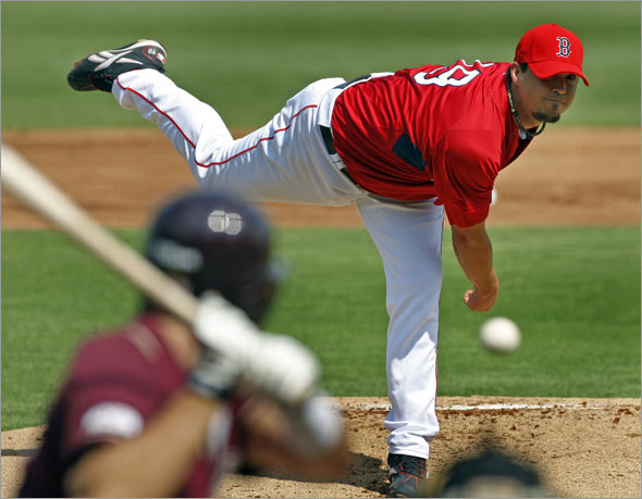 The Red Sox kicked off the Grapefruit League season with a game at City of Palms Park vs. Boston College. Red Sox starting pitcher Josh Beckett is shown as he fires a pitch to Boston College's Harry Darling in the top of the first inning.