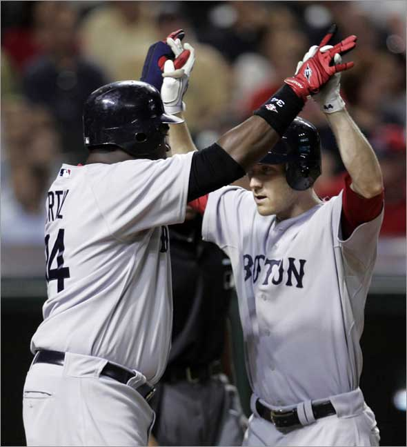 Jason Bay, right, is congratulated by David Ortiz after Bay hit a three-run home run off Cleveland Indians pitcher Kerry Wood in the ninth inning of a baseball game, Monday, April 27, 2009, in Cleveland. Ortiz and Dustin Pedroia scored. The Red Sox won 3-1.