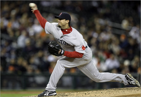 Red Sox pitcher Josh Beckett throws against the Detroit Tigers in the seventh inning of a baseball game in Detroit, Wednesday, June 3, 2009.