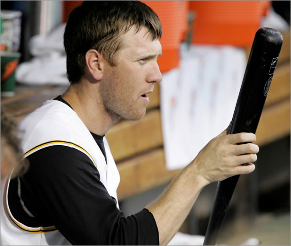 Jason Bay sits on the bench with his bat during the third inning of a baseball game against the Colorado Rockies in Pittsburgh Wednesday, July 30, 2008.
