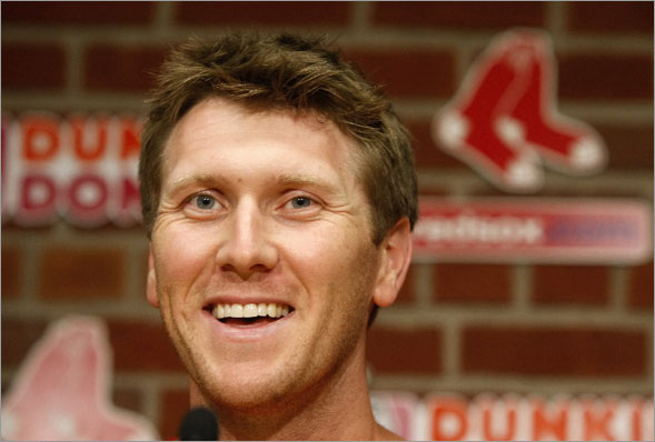 New Sox left fielder Jason Bay makes his entrance at a introductory press conference this afternoon.