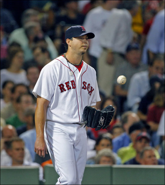 Josh Beckett did not get win number 21, here he reacts as he gets the ball back after a Twins sacrifice fly in the third inning put Minnesota ahead 3-2 at the time.