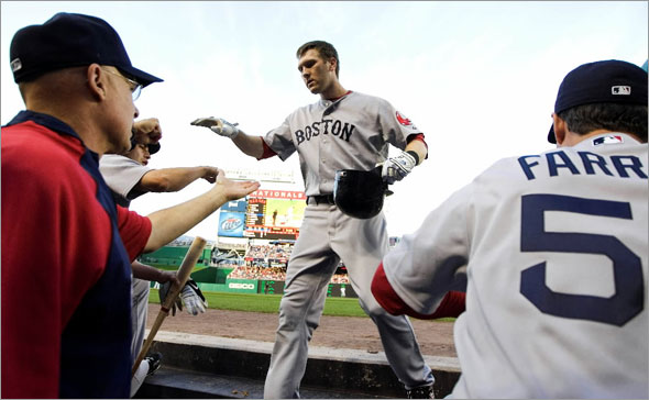 Boston Red Sox's Jason Bay, center, is congratulated by teammates after he hit a rome run during the second inning of a baseball game against the Washington Nationals, Tuesday, June 23, 2009, in Washington.