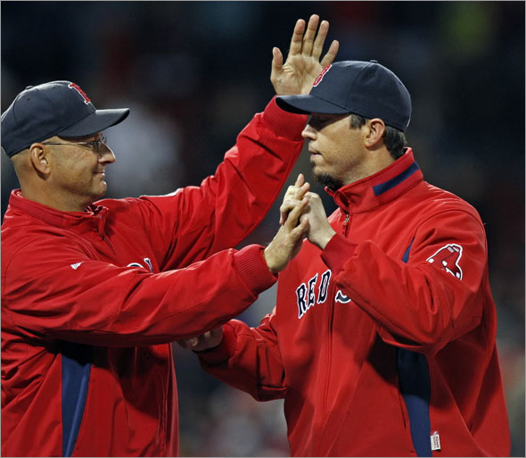 Red Sox manager Terry Francona (left) has a smile and a pat on the head for winning pitcher  Josh  Beckett during the post game congratulations on the field. The Boston Red Sox play the New York Yankees at Fenway Park.