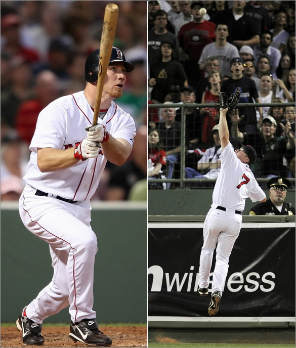 Red Sox right fielder J.D. Drew homers and leaps to catch a deeply hit ball by Tampa Bay catcher Dioner Navarro during the 5th inning at Fenway Park in Boston, MA Tuesday, June 3, 2008.