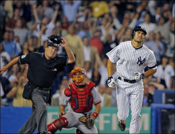 Johnny Damon as well as Jason Varitek and umpire Derryl Cousins all get a good look as his seventh inning two run home run leaves the yard.