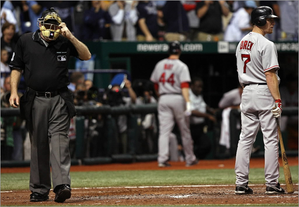 J.D. Drew of the Boston Red Sox reacts after striking out to end the eighth inning against the Tampa Bay Rays in game seven of the American League Championship Series during the 2008 MLB playoffs on October 19, 2008 at Tropicana Field in St Petersburg, Florida