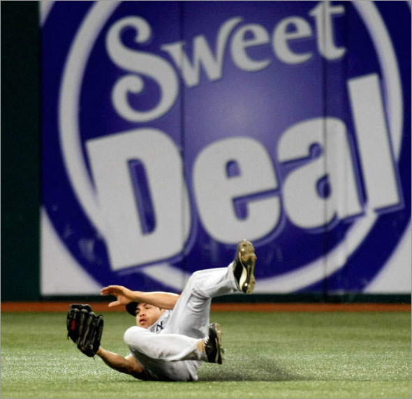 Jacoby Ellsbury makes a sliding catch robbing Tampa Bay Rays' Jason Bartlett of a hit during the eighth inning of a baseball game Tuesday