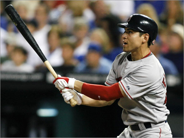 Boston Red Sox's Jacoby Ellsbury hits a three-run home run in the seventh inning of a baseball against the Kansas City Royals Wednesday, Aug. 6, 2008, in Kansas City, Mo. Sean Casey and Jason Bay also scored on the home run.