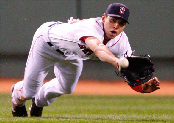 Jacoby Ellsbury of the Boston Red Sox makes a diving catch on a ball hit by Jose Guillen #11 of the Kansas City Royals at Fenway Park