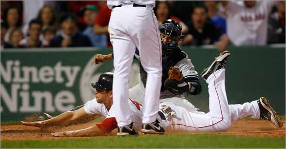 Red Sox's Jacoby Ellsbury steals home under the tag of New York Yankees catcher Jorge Posada during the fifth inning