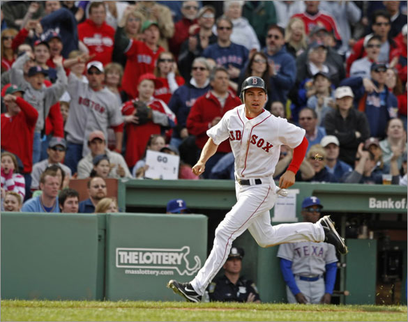 The Boston Red Sox Jacoby Ellsbury rounding 3rd base scoring from first base on teammate Jed Lowrie's double against the Texas Rangers during 8th inning action at Fenway Park on Sunday April 20, 2008.